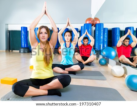 Yoga training exercise in fitness gym people group relaxed hands up - stock photo