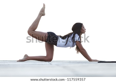 Yoga woman in sportswear isolated on white background - stock photo