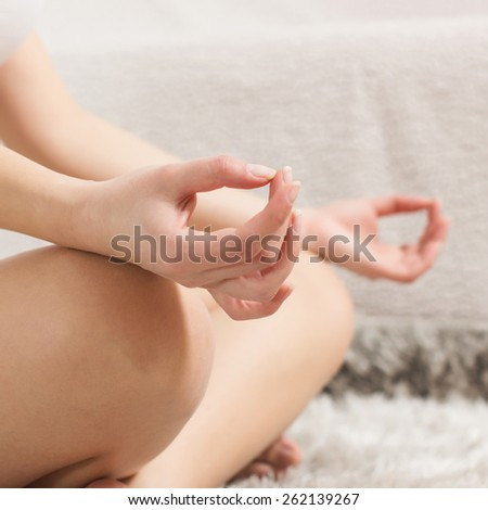 Yoga Woman Meditating Relaxing at home.Close-up of unrecognizable female hand in lotus posture. Healthy Lifestyle. - stock photo