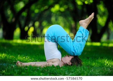 Yoga. Young girl goes in for sports. - stock photo