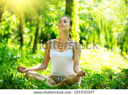 Yoga. Young Woman doing Yoga Exercises Outdoor. Beautiful Girl practicing yoga in the park - stock photo