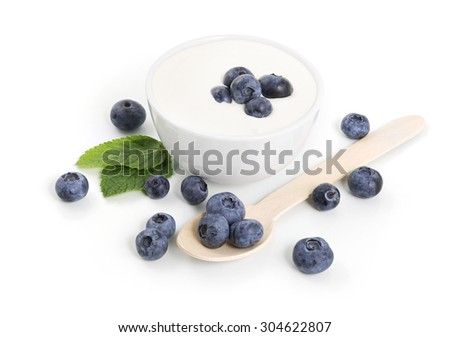 Yogurt in a bowl with blueberries on white background - stock photo