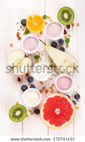Yogurt with fresh fruits - stock photo