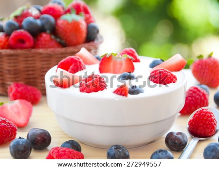 Yogurt with fresh fruits in white bowl - stock photo