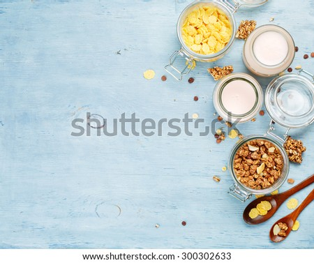 Yogurt with muesli and cornflakes. Health and diet concept. Food background with copyspace - stock photo