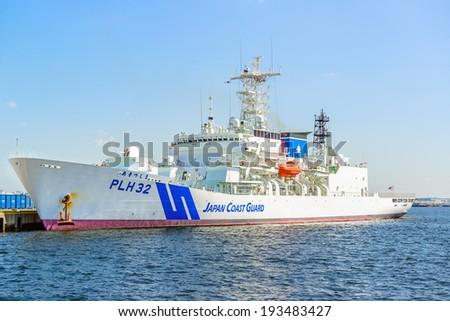 YOKOHAMA, JAPAN - MAY 18: Patrol vessel of Akitsushima leaves a port in Yokohama Base, Japan on May 18, 2014. It is the largest patrol vessel of the Japan Coast Guard, and in the world. - stock photo