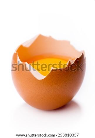Yolk in broken egg isolated on white background - stock photo