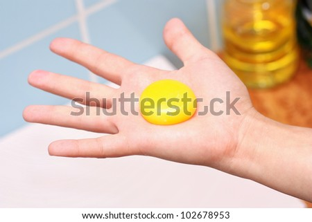 Yolk in hand - stock photo