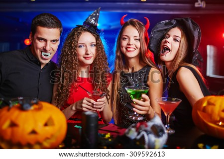 Yong people making sinister faces - stock photo