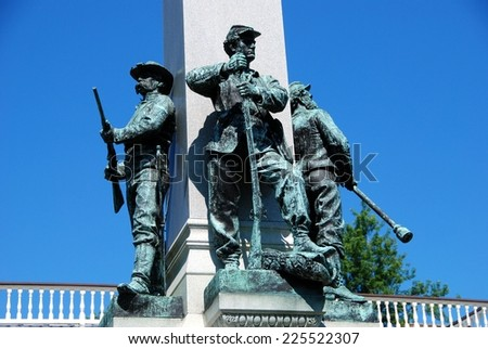 Yonkers, NY:  Civil War soldier statues with their weapons stand at the base of the Yonkers 1892 Civil War Memorial - stock photo