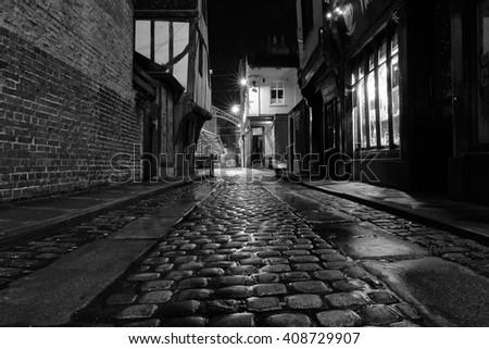 YORK, UK - April 12: Cobbled street at night on April 12, 2016 in York. - stock photo