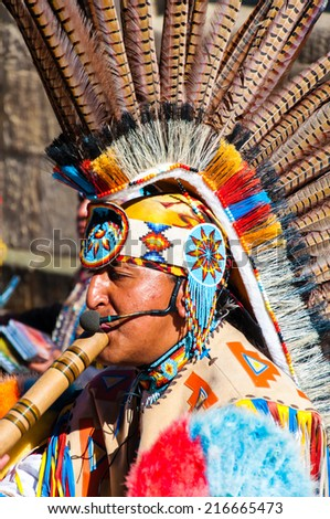 York, United Kingdom - August 9, 2014: Native American Indian tribal group play music and sing on the street in historical city of York, England. - stock photo