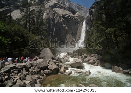 YOSEMITE, CA - MAY 23: Tourists walk the trail up to Yosemite Falls on May 23, 2009 in Yosemite, CA.  Yosemite National Park proves to be a favorite destination in these cash strapped times. - stock photo