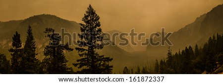 Yosemite panorama with dust air polution from fire august 2013 - stock photo