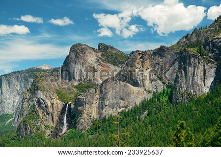 Yosemite Valley with mountains and waterfalls in day - stock photo