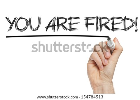 You are fired written on a blackboard - stock photo