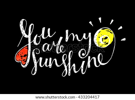 You are my sunshine inscription on black background. Grunge style vintage hand drawn calligraphy lettering for valentines day card, t-shirt, postcard, save the date card. Raster copy of vector file. - stock photo