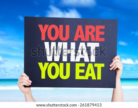 You Are What You Eat card with beach background - stock photo