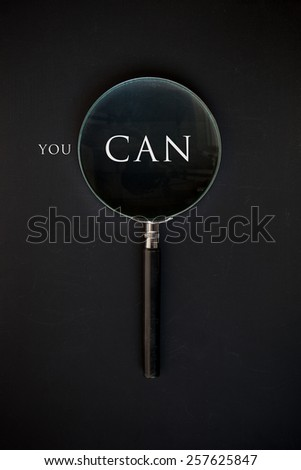you can and magnifying glass - stock photo