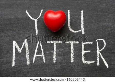 you matter phrase handwritten on school blackboard - stock photo