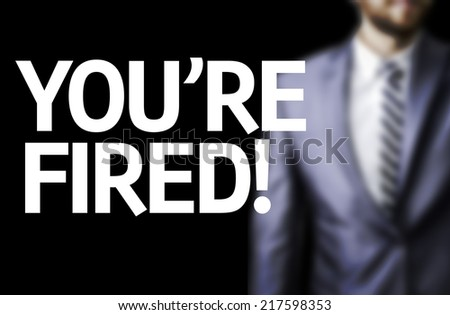 You're Fired! written on a board with a business man on background - stock photo