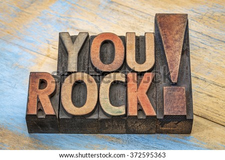 You rock compliment in vintage letterpress wood type printing blocks stained by color inks - stock photo