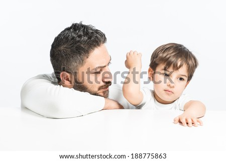 Yound boy angry with his father - stock photo