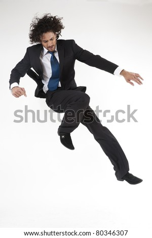 young active businessman jumping and rushing to the office in hurry. - stock photo