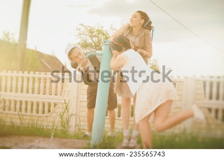 young active girls and guy hipsters have a drink water summer - stock photo