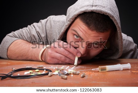 Young addicted man - stock photo