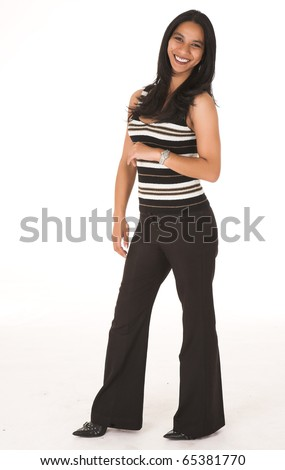 Young adult African-Indian businesswoman in casual office outfit with black pants, a striped top and high heels on a white background. Not Isolated - stock photo