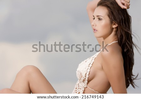 young adult attractive and sensuality fashion pretty brunette sexy woman in white bikini on the beach - stock photo