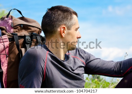 young adult backpacker have a rest. close up portrait - stock photo