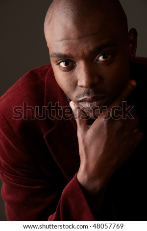 Young Adult black african businessman wearing a dark smart-casual suit. Not Isolated. - stock photo