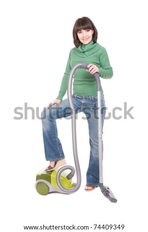 young adult brunette woman with vacuum. over white background - stock photo