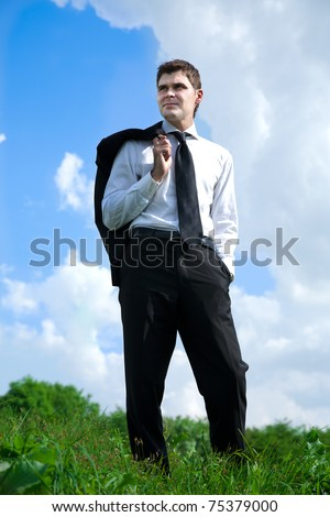 young adult businessman working in country - stock photo