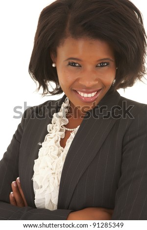 Young adult Caucasian businesswoman wearing a grey suit with curly brown hair on a white background. NOT ISOLATED - stock photo