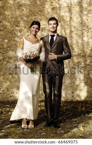 Young adult couple get married in a country church - stock photo