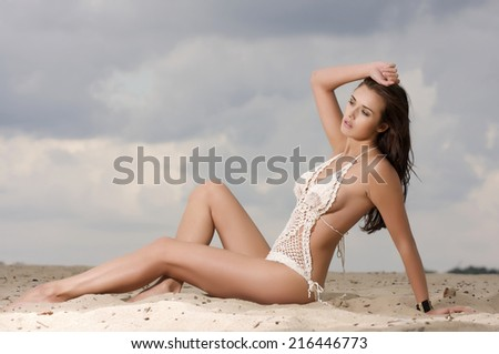 young adult fashionable pretty sensuality and attractive brunette sexy woman in white bikini on the beach - stock photo