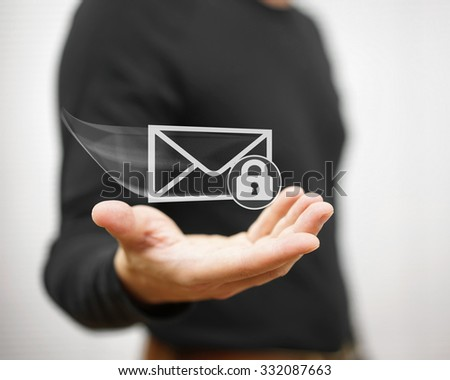 Young adult holding flying envelope witch padlock, secure communication concept - stock photo