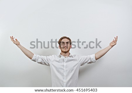 Young Adult Male in White Shirt Gesturing Arms Wide Open - stock photo