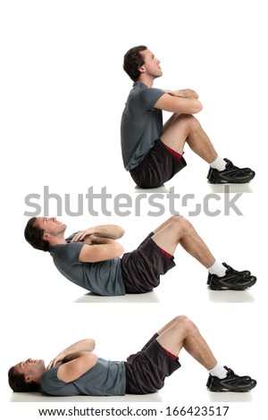 Young adult man doing sit ups. Studio shot over white. - stock photo