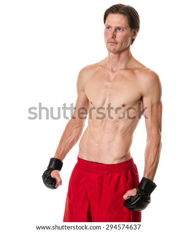 Young adult martial artist. Studio shot over white. - stock photo
