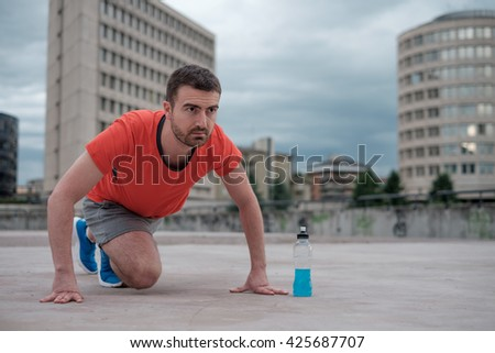 young adult sportsman working out in the city - stock photo