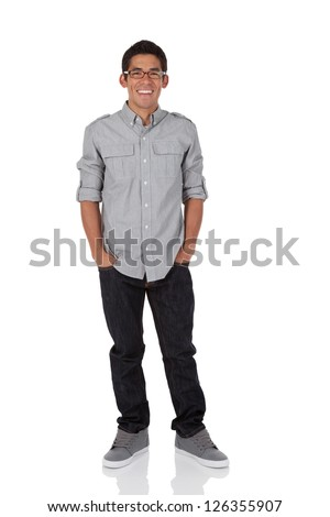 Young adult standing with hands in pocket isolated on white - stock photo