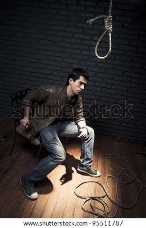 young adult stressed considering suicide - stock photo