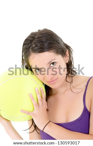 young adult woman with tennis ball. over white background - stock photo