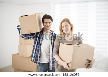 young adults moving in new home - stock photo
