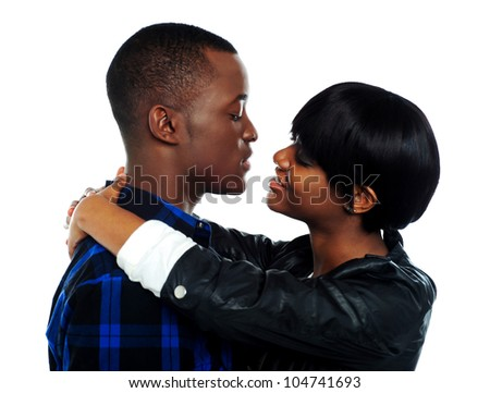 Young affectionate african couple hugging. Isolated over white background - stock photo