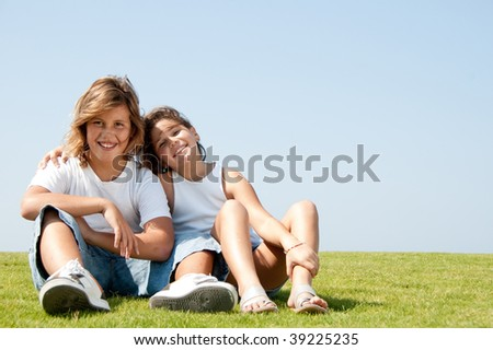 Young affectionate brother and sister on natural background - stock photo